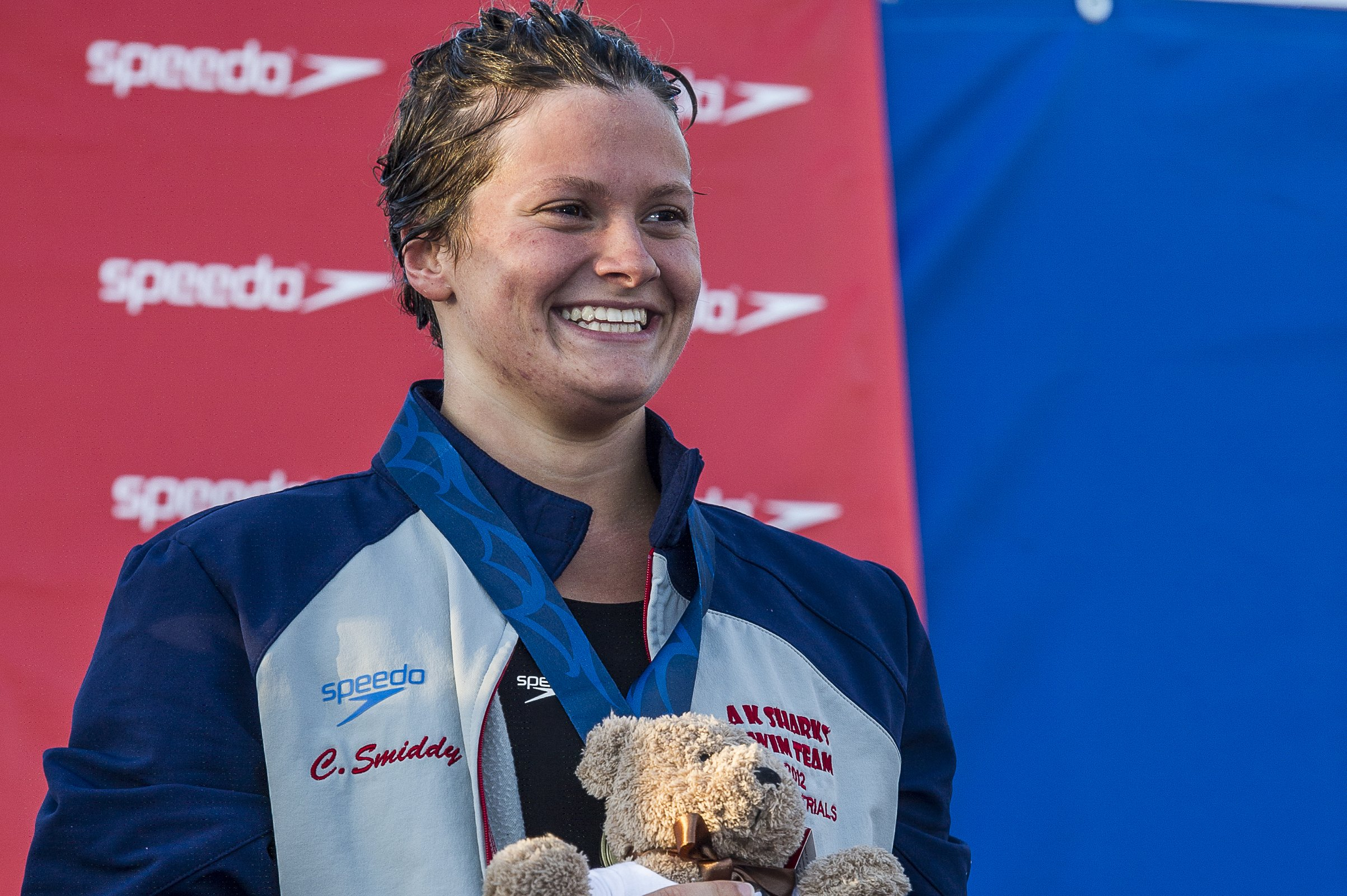 Clara Smiddy wins the 100 backstroke.