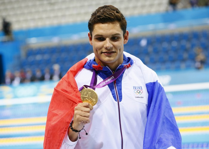 Aug 3, 2012; London, United Kingdom; Florent Manaudou (FRA) celebrates after winning the gold medal in the men's 50m freestyle final during the London 2012 Olympic Games at the Aquatics Centre. Mandatory Credit: Rob Schumacher-USA TODAY Sports
