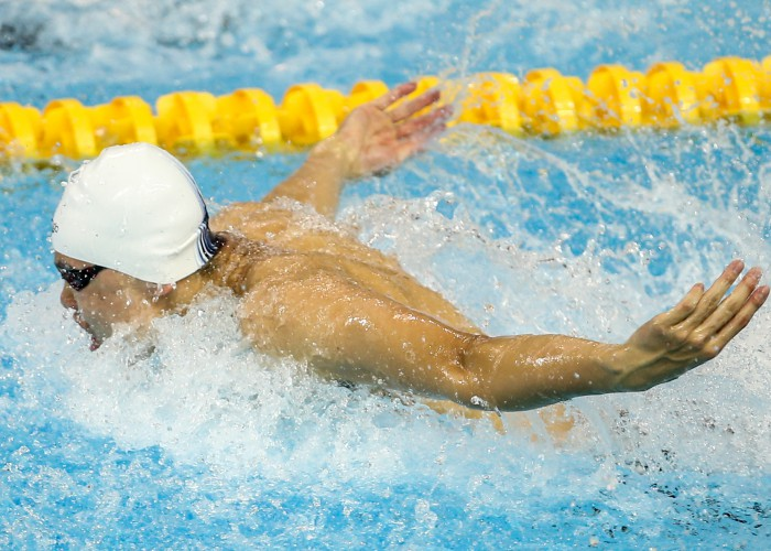 (140821) -- NANJING, Aug. 21, 2014 (Xinhua) -- Gold Medalist Yu Hexin of China competes during Men's 50m butterfly of swimming at the Nanjing 2014 Youth Olympic Games in Nanjing, east China's Jiangsu Province, Aug. 21, 2014. (Xinhua/Yang Lei)(zc)