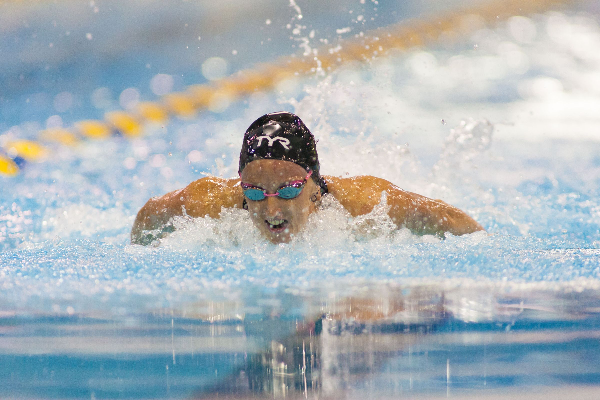 May 15, 2015; Charlotte, NC, USA; Claie Donahue swims the 100 LC Meter Butterfly during the finals at the Mecklenburg County Aquatic Center. Mandatory Credit: Jeremy Brevard-USA TODAY Sports