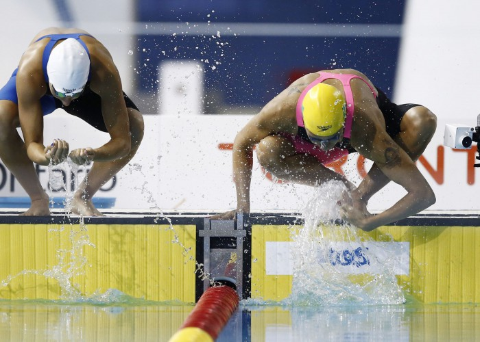 Jul 14, 2015; Toronto, Ontario, CAN; Jessica Camposano of Colombia (left) and Joanna Maranhao of Brazil splash water on themselves before the women's 200m butterfly swimming preliminaries during the 2015 Pan Am Games at Pan Am Aquatics UTS Centre and Field House. Mandatory Credit: Rob Schumacher-USA TODAY Sports