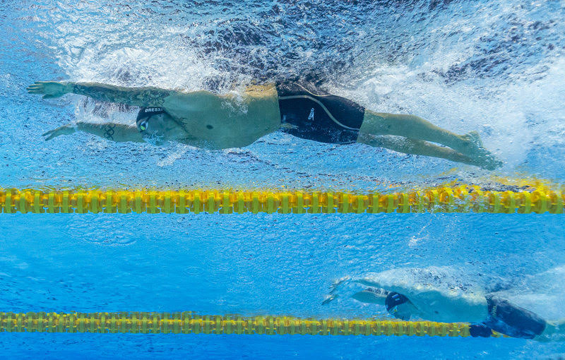 Caeleb Dressel (top) of the United States of America (USA) on his way to a New World Record in the men's 100m Butterfly Semifinal during the Swimming events at the Gwangju 2019 FINA World Championships, Gwangju, South Korea, 26 July 2019.