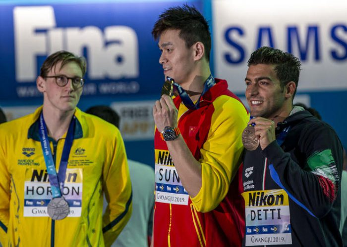 (L-R) Second placed Mack Horton of Australia keeps his distance to winner Yang Sun of China while they pose with their medals for photographers after competing in the men's 400m Freestyle Final during the Swimming events at the Gwangju 2019 FINA World Championships, Gwangju, South Korea, 21 July 2019. Gabriele Detti of Italy finishes third.