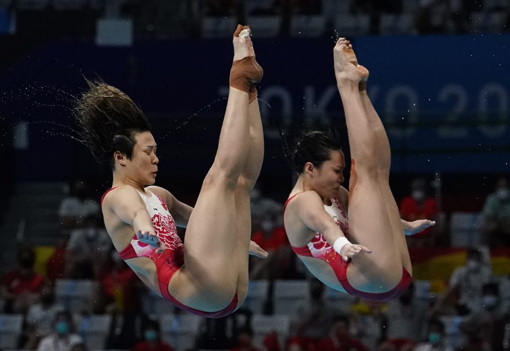 Jul 25, 2021; Tokyo, Japan; Shi Tingmao and Wang Han (CHN) during the women's synchronized 3m springboard diving competition during the Tokyo 2020 Olympic Summer Games at Tokyo Aquatics Centre. Mandatory Credit: Rob Schumacher-USA TODAY Network
