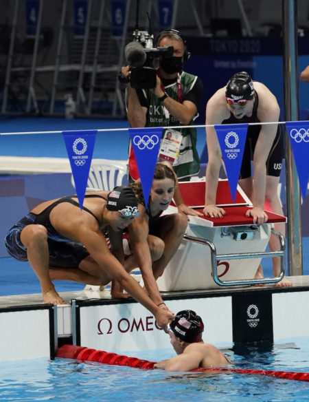Aug 1, 2021; Tokyo, Japan; Torri Huske (USA), Regan Smith (USA) , Lydia Jacoby (USA) and Abbey Weitzeil (USA) react after their second place finish in the women's 4x100m medley final during the Tokyo 2020 Olympic Summer Games at Tokyo Aquatics Centre. Mandatory Credit: Rob Schumacher-USA TODAY Sports