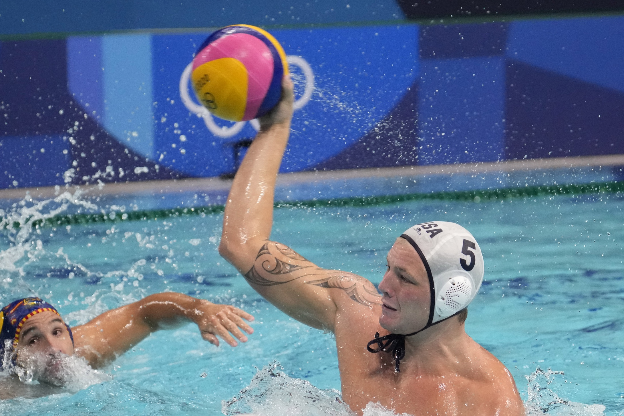 Aug 4, 2021; Tokyo, Japan; Team United States driver Hannes Daube (5) throws the ball against Spain in a men's water polo quarterfinal during the Tokyo 2020 Olympic Summer Games at Tatsumi Water Polo Centre. Mandatory Credit: Robert Hanashiro-USA TODAY Sports