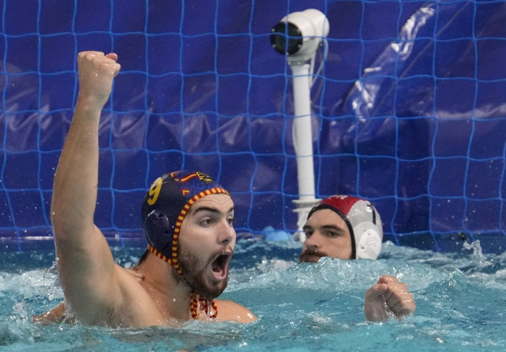 Aug 4, 2021; Tokyo, Japan; Team Spain centre forward Roger Tahull Compte (9) celebrates a goal against USA in a men's water polo quarterfinal during the Tokyo 2020 Olympic Summer Games at Tatsumi Water Polo Centre. Mandatory Credit: Robert Hanashiro-USA TODAY Sports